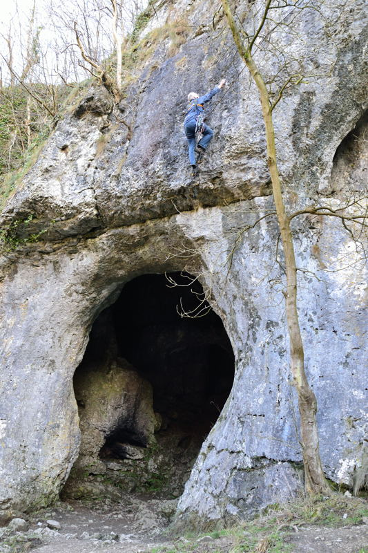Rock climber above Dove Holes, Dovedale.