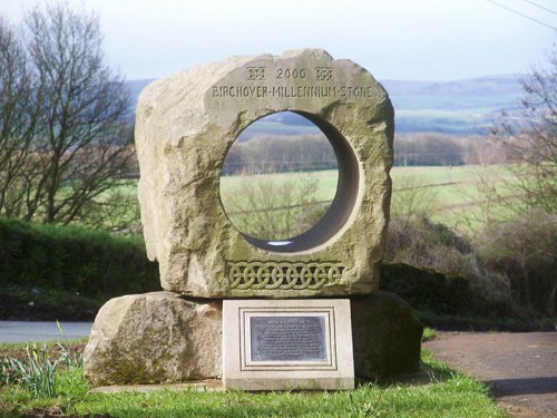 Birchover Millennium Stone - Sited opposite the Druid Inn, the local quarry donated the stone and Mark Eaton carried out the carving. The stone is approximately a ton and a half in weight