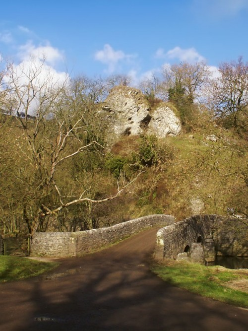Nan Tor Cave and the bridge over the River Manifold at Wetton Mill