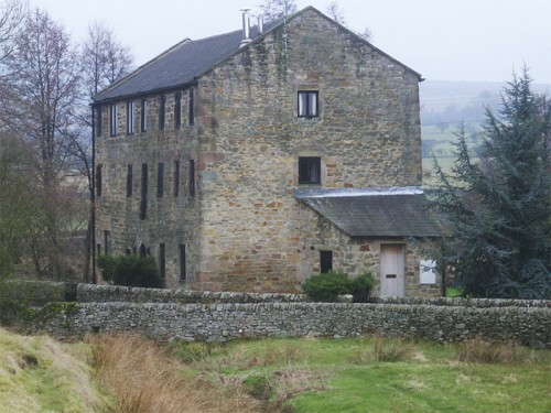 Brund Mill is a converted former corn mill with water wheel and restored mill workings