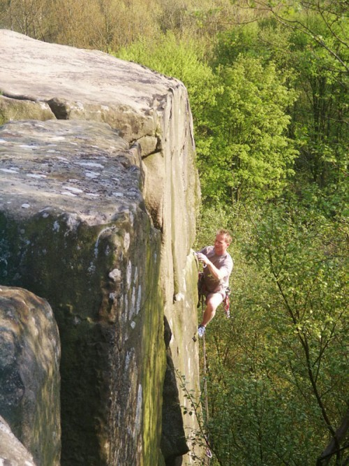 A rock climber on Cratcliff Tor