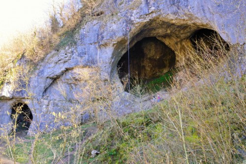 Dove Holes - The word Dove comes from the Saxon word 'Dubh', meaning black, the local rock climbers call the larger cave The Bat Cave! The larger cave is about 30ft high and 60ft wide. On the opposite side of the Dove, is Shepherd's Abbey Rocks and caves