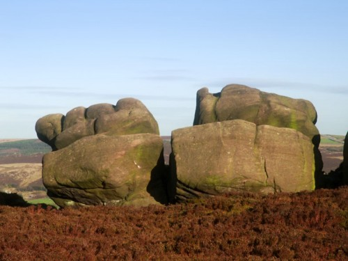 Gritstone like clenched fists shaped by the wind, rain and young rock climbers hands.