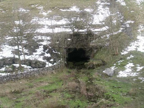 The source of the River Lathkill is Lathkill Head Cave during wet winters the water comes gushing out of the cave.