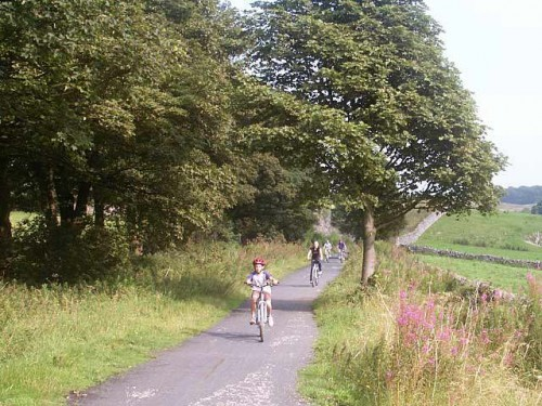 A family cycling on the Tissington Trail