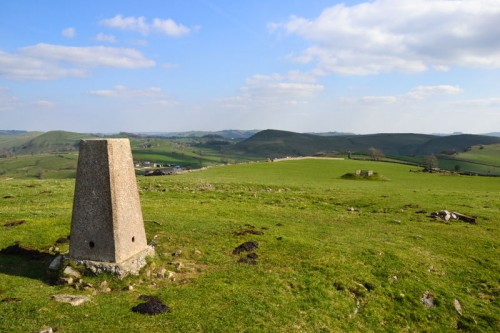 Trigpoint on Ecton Hill looking towards Wetton Hill
