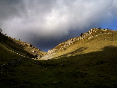 Looking up to the limestone escarpment in Lathkill Dale